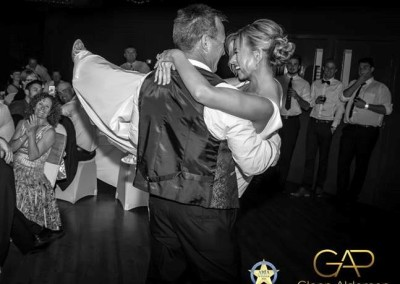Wedding couple perform a dance lift in their bridal waltz in Adelaide