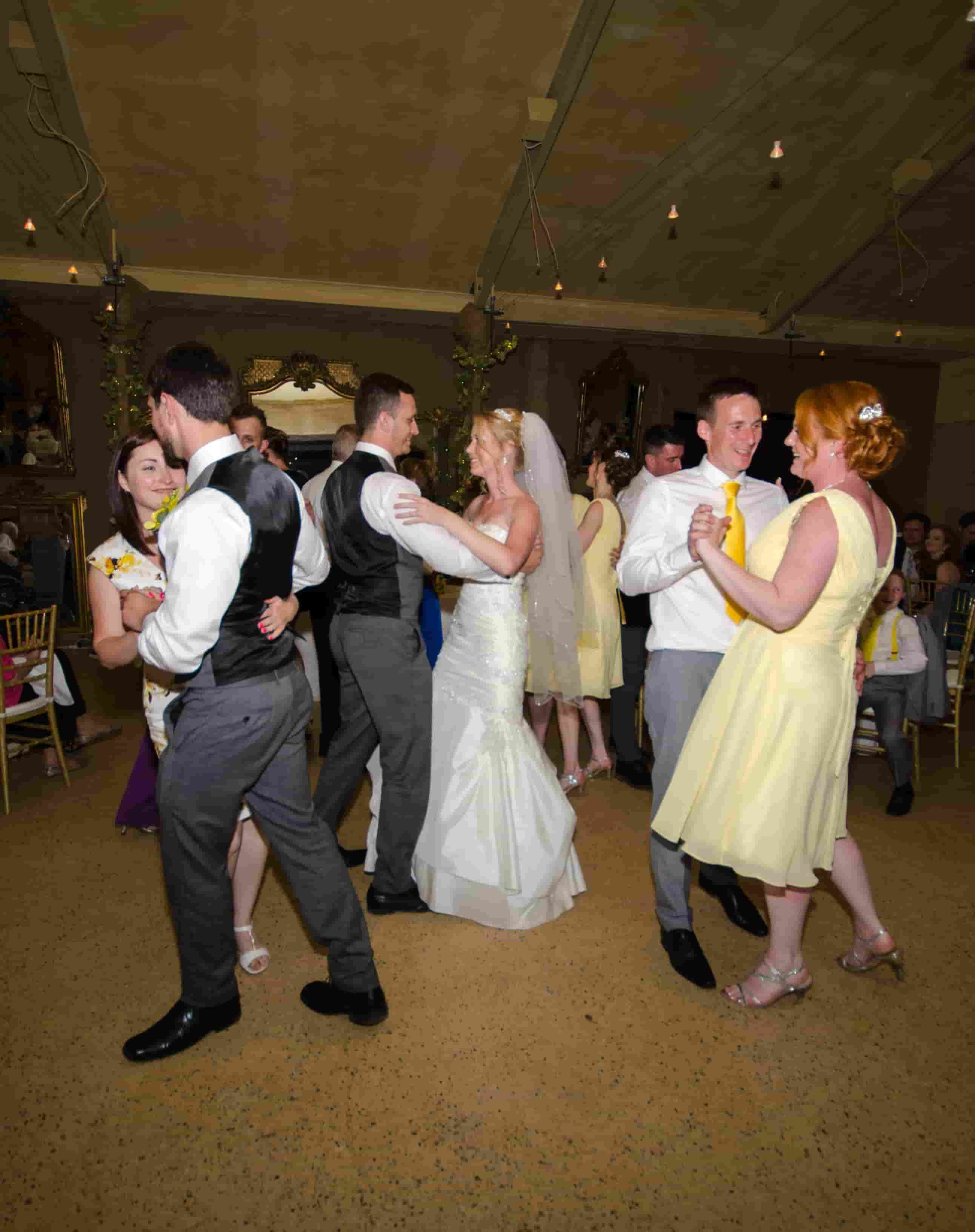 Bridal party on the dance floor at wedding
