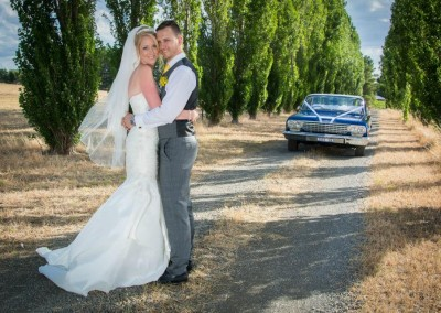 Wedding couple with decorated car