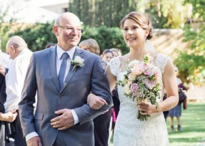 Father of the bride walks his daughter down the aisle